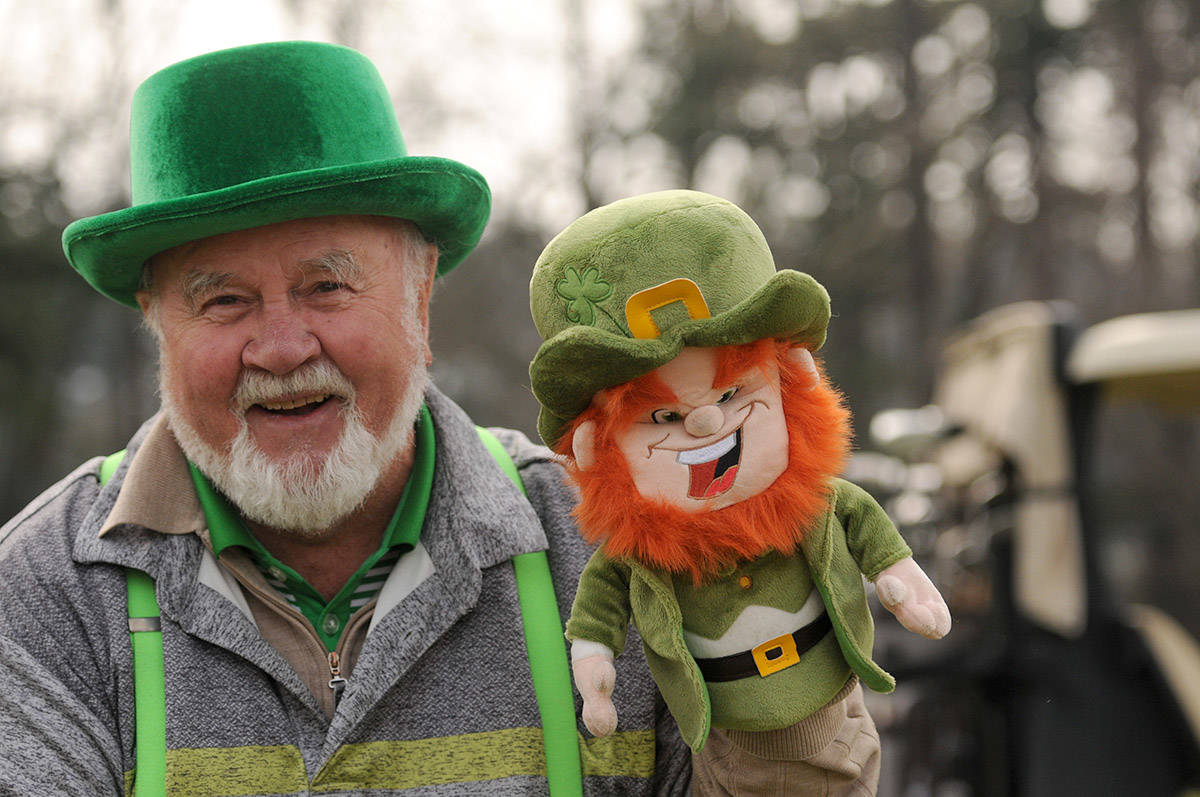 Patrick O'Shea holds up his leprechaun golf head cover during a round of golf at Meadowlands Golf and Country Club on St. Patrick's Day on March 17, 2021. (Jenna Hauck/ Chilliwack Progress)